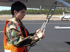 NC-170 Cadet A/1C Rory Gannon practices proper way to secure aircraft.